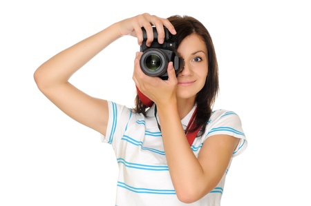 Teenage girl photographer with camera, isolated on white photo