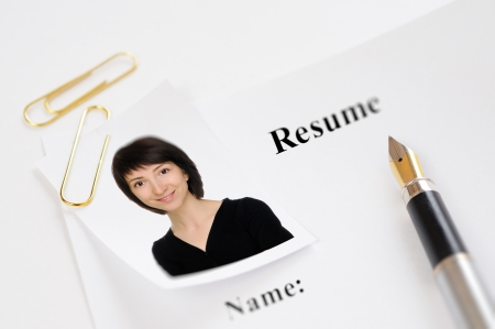 Resume form with a photograph and fountain pen Stock Photo - 14567494