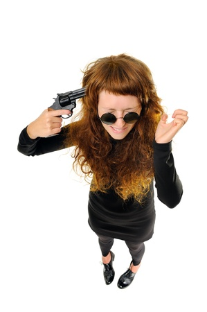 holding gun to head: Woman holding a gun to her head  Top view  Isolated on white Stock Photo