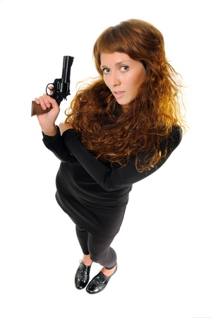 Young beautiful woman with a gun  Top view, isolated on white