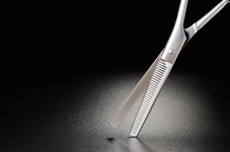 hairdressing scissors: Professional hairdressing scissors on a black matt background