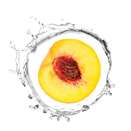 Half of yellow peach in water splash photo