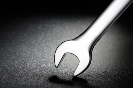 Steel wrench on a black textured background Stock Photo - 15284002