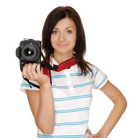 Teenage girl photographer with camera, isolated on white photo
