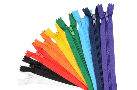 Zippers lined in a row in the manner of the rainbow  Isolated on white 版權商用圖片