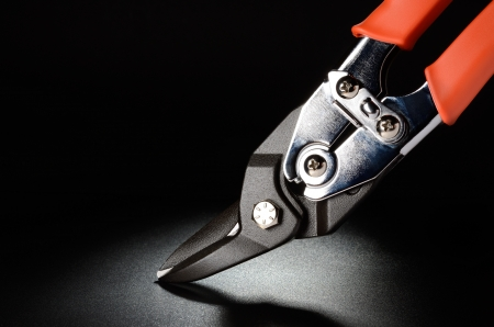 Aviation tin snips on black grained surface Stock Photo - 17621046