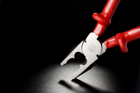 Combination Pliers on the black grained surface Stock Photo - 17987168