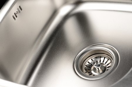Stainless steel sink with drain  Closeup  Stock Photo