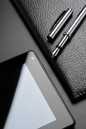 Business still life  card holder, tablet, fountain pen