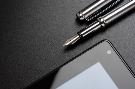 Business still life  tablet, fountain pen