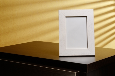 Photo frame on the nightstand  With space for your photo  Stock Photo