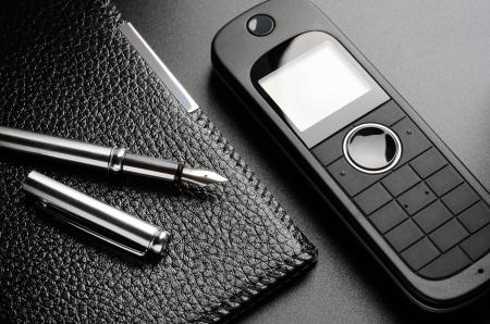Telephone, pen, organizer  Contact us concept