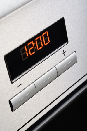 Digital timer of stainless steel oven  Macro shot  photo