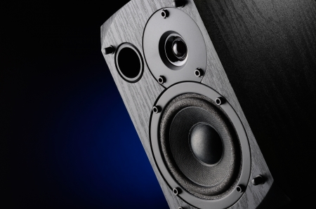 Multimedia speaker system with different speakers closeup over black background 版權商用圖片