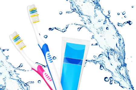 Toothbrushes and toothpaste tube other water splash. Tooth care concept photo