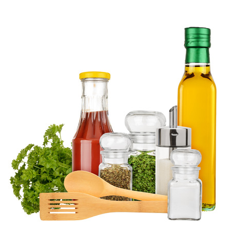 Set of seasoning and condiments isolated on a white background