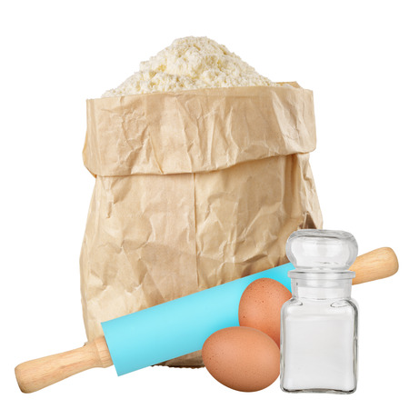 Bag of flour isolated with rolling pin, salt and eggs isolated  on white background photo