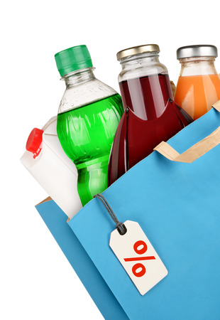 Grocery bag with bottles isolated on white background photo