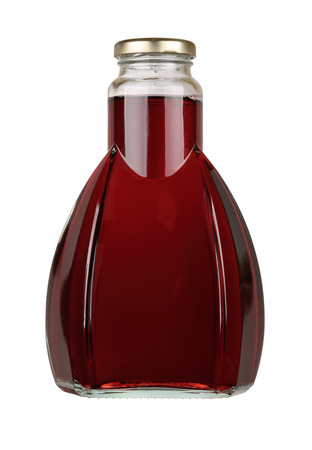 Bottle of red juice isolated on a white background photo