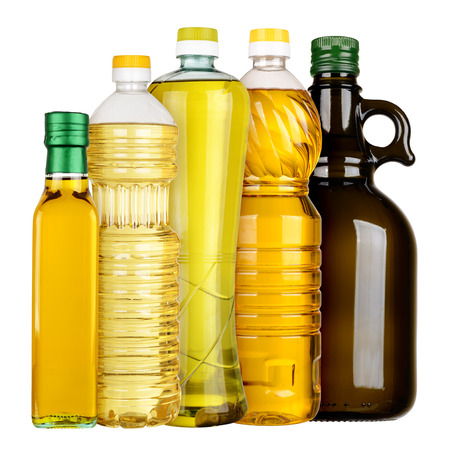 Olive and sunflower oil in the bottles set isolated on white background photo