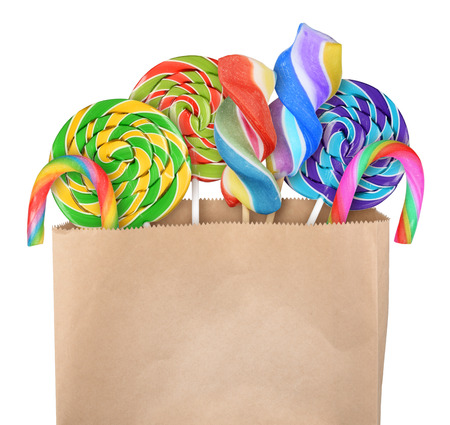 Lollipop candy in paper bag isolated on white background photo