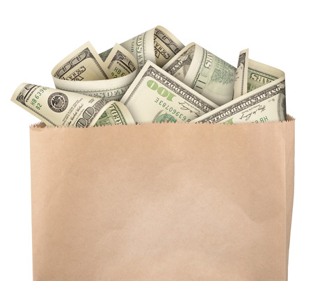 Money in paper bag isolated on white background photo
