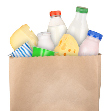 Grocery bag with dairy products isolated on white background Фото со стока