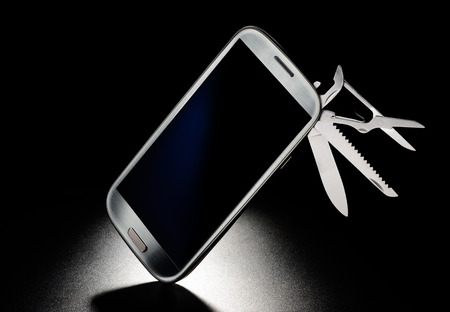 multipurpose: Mobile phone with pocket knife. Multi functional concept Stock Photo