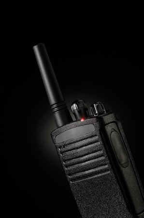 Portable radio transceiver on black background