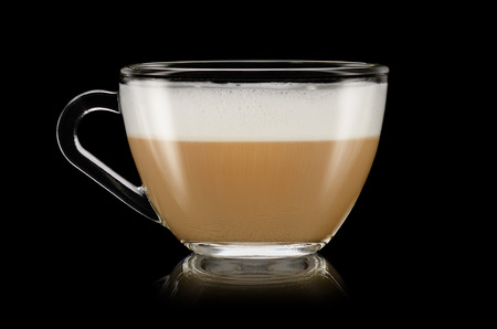 A cup of cappuccino on the black background Imagens