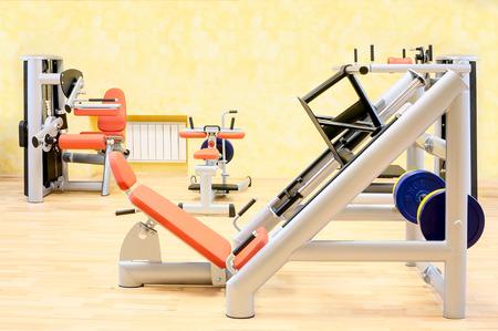 Gym. Fitness club weight training equipment photo