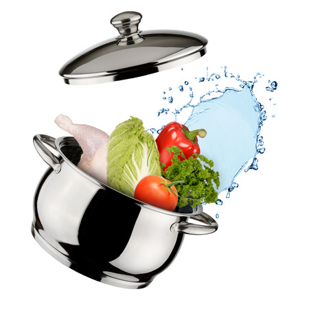 Cooking concept. Saucepan with vegetables and water isolated on white background photo