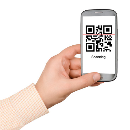 Scanning QR code with mobile smart phone isolated on white background Stock Photo