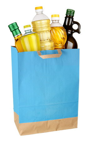 Shopping bag with cooking oil isolated on white background. Full size photo
