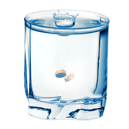 fizzy: Fizzy pill in the glass of water. Isolated on a white background with clipping path