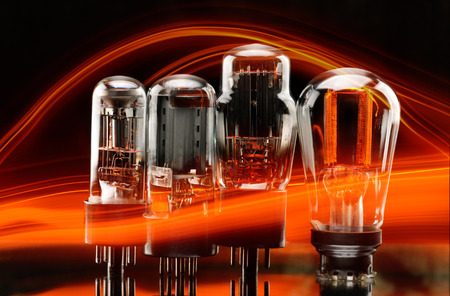 triode: Old electronic vacuum lamp with orange light glow