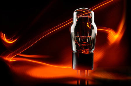 Old electronic vacuum lamp with orange light glow