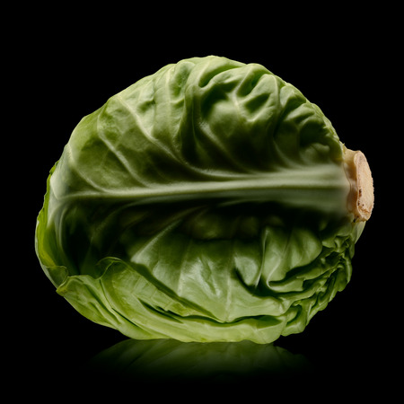 Green cabbage on black background. Low key. With clipping path