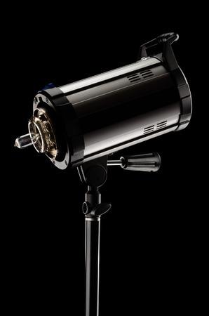 strobe: Studio flash strobe on a black background. Low key technique