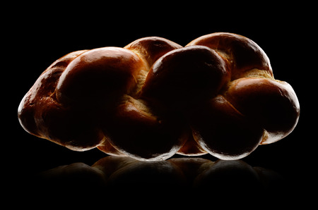 challah: Fresh challah bread on black background. Low key technique Stock Photo