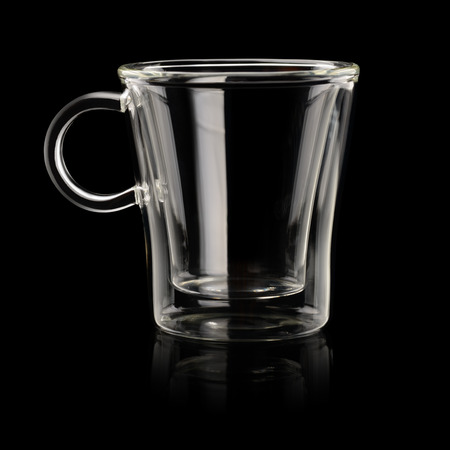 glass cup: Empty transparent espresso coffee cup on black background