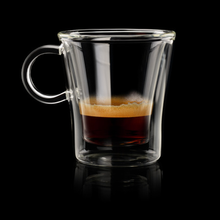 Coffee Ristretto in transparent cup on black background