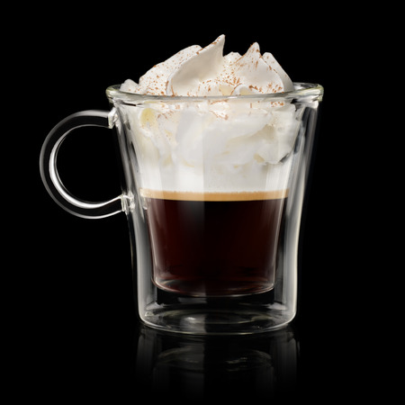 Coffee vienna (con panna) in transparent cup on black background Фото со стока