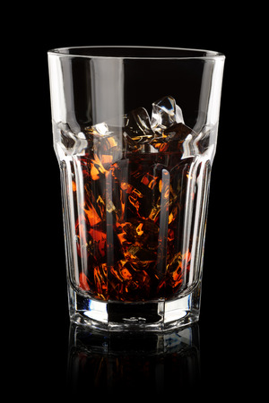 low glass: Iced cola in transparent glass on black background. Low key technique Stock Photo