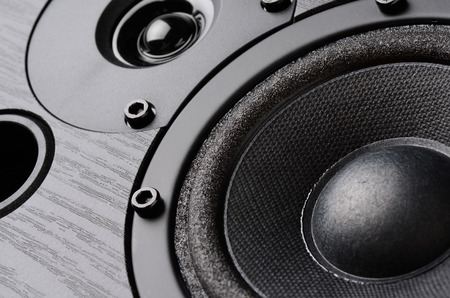 speakers: Multimedia speaker system with different speakers closeup over black background Stock Photo