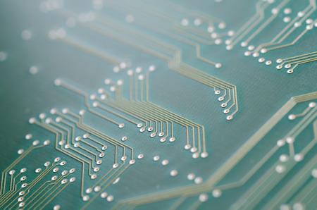printed: Macro shot of a green printed circuit board