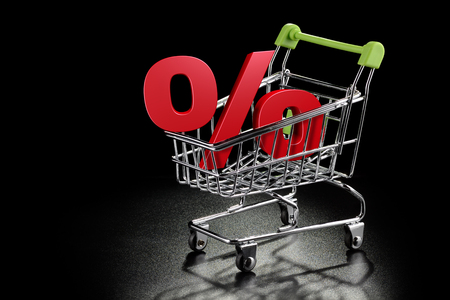 shopping buggy: Shopping cart with percentage sign on a black textured background with copy-space Stock Photo