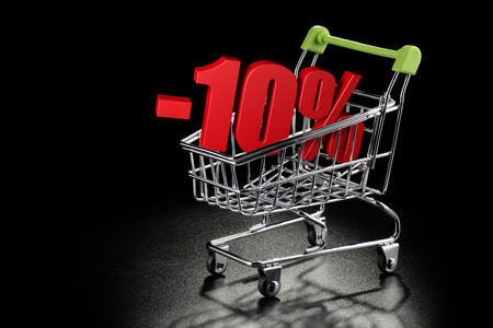ten empty: Shopping cart with 10 % percentage rate on a black textured background with copy-space Stock Photo