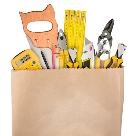 cardboard box: Shopping bag with a different work tools isolated on white background