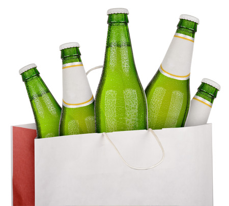 dewed: Bag with green beer bottles isolated on white background